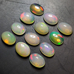5.69ct Ethiopian Noble Opal oval cabochon 7.0x5.1mm 12pc